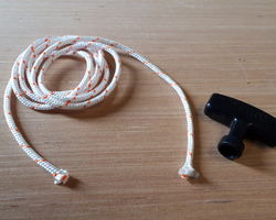 Starter cord and handle for mowers and sweepers